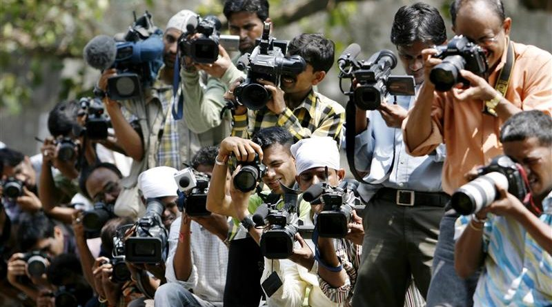 Photographers and video cameramen gather outside the special court in Mumbai