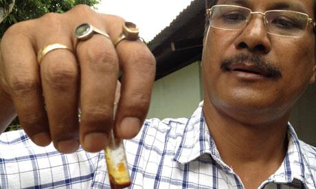 Dr Anuj Baruah holds vial of bhut jolokia oil marathipizza