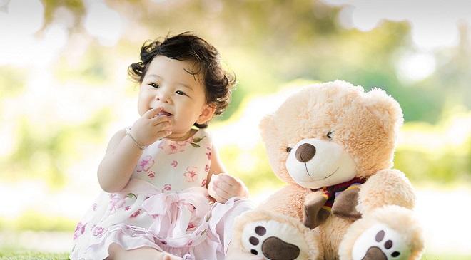 teddy bear and child InMarathi