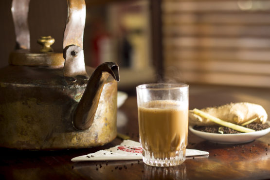 Cutting Chai (Tea) served in the traditional kettle - Food Photography