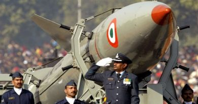 Indian soldiers stand beside missile Prithvi in New Delhi