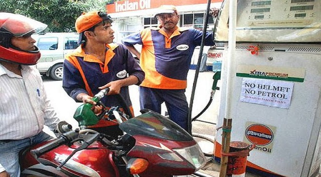 man filling petrol bike InMarathi
