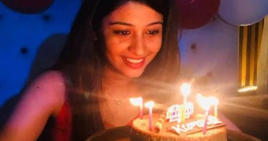 Girl blowing candle Inmarathi