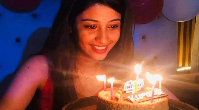 Girl blowing candle Inmarathi