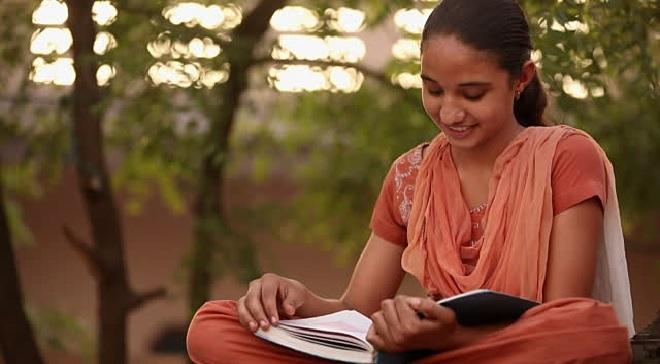 indian girl reading book inmarathi