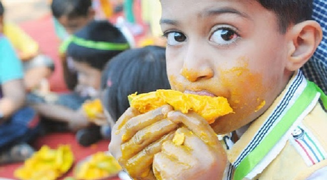 boy eating mango inmarathi