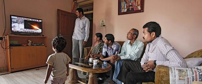 family-watching-tv inmarathi